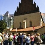 Tourists in Prague outside the Old-New synagogue. Photo © Ruth Ellen Gruber