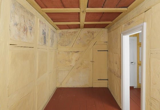 The Schwabach sukkah, showing the wall paintings and coffered ceiling that can be opened. Photo © Jewish Museum Franconia