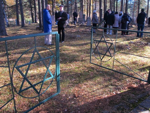 Conference participants at the Jewish cemetery in Svencioneliai, which was restored through the efforts of one of them, Dr. Michael Lozman
