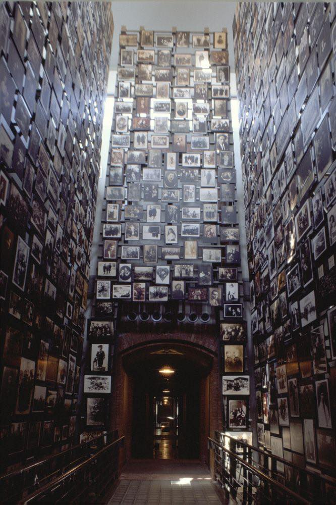This three-story tower in the Museum's Permanent Exhibition displays photographs from the Yaffa Eliach Shtetl Collection. — Photo: US Holocaust Memorial Museum